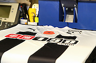 A a poppy is printed on a replica shirt in The Hornets Shop to mark the 100th anniversary of the start of WWI before the Watford v Millwall Sky Bet Championship match at Vicarage Road, Watford<br /> Picture by David Horn/Focus Images Ltd +44 7545 970036<br /> 01/11/2014