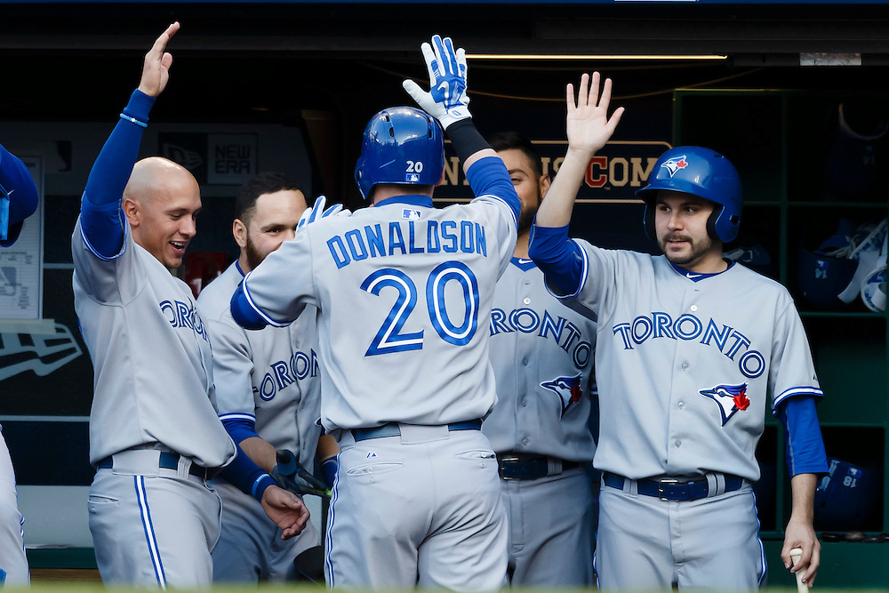 May 1, 2015; Cleveland, OH, USA; Toronto Blue Jays third baseman Josh Donaldson (20) receives congratulations from teammates after he hits a home run in the first inning against the Cleveland Indians at Progressive Field. Mandatory Credit: Rick Osentoski-USA TODAY Sports