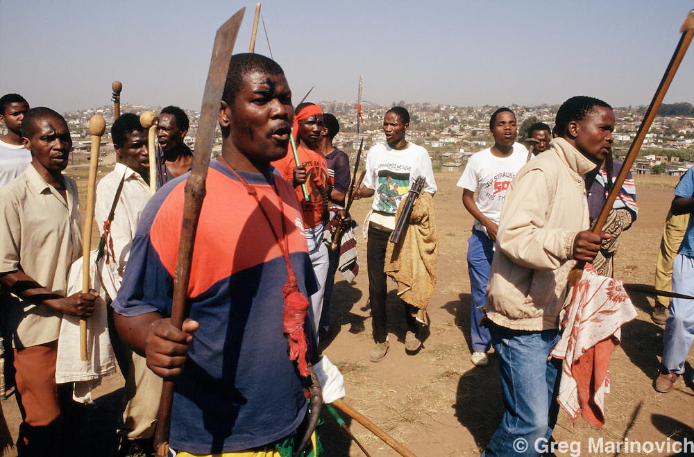 Xhosa ANC supporting warriors prepare for battle  in Thokoza south of Johannesburg, South Africa, 1991.