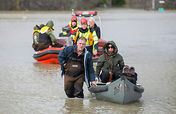 A man and a woman are evacuated from their home by Surete du Quebec police officers in the town of Rigaud, Quebec, Canada., west of Montreal, Monday, May 8, 2017, following flooding in the region. Photo by Graham Hughes /The Canadian Press/ABACAPRESS.COM
