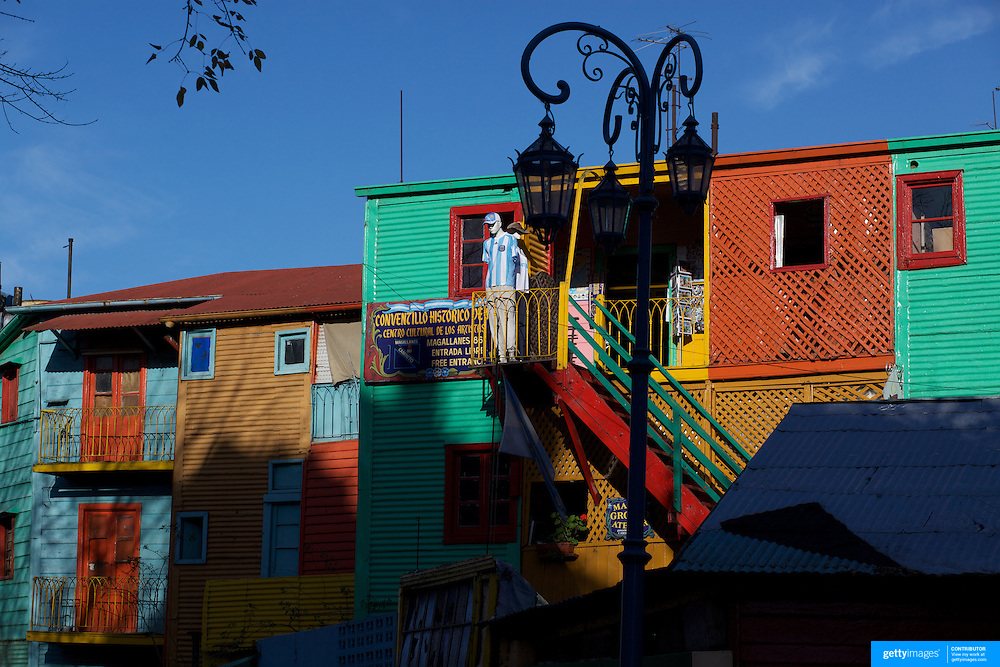 The colourful painted houses of the tourist region of La Boca near the famous Boca Juniors football stadium, La Bombonera, in La Boca region of Buenos Aires, Argentina, 25th June 2010. Photo Tim Clayton..