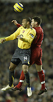 Photo: Aidan Ellis.<br /> Liverpool v Arsenal. The Barclays Premiership. 14/02/2006.<br /> Liverpool's Steve Finann and Arsenal's Thierry Henry battle for the ball