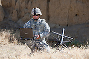 Military computing in tactical location.  Model-released man using rugged or ruggedized laptop computer.  Meets current US Department of Defense (DoD) requirements for use in advertising -- person is not an active duty member of the US armed forces and is wearing no US-specific insignia.  ..REPRODUCTION PROHIBITED WITHOUT WRITTEN CONSENT FROM THE PHOTOGRAPHER OR FROM MILITARY STOCK PHOTOGRAPHY.
