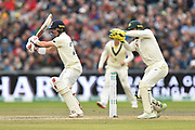 Rory Burns of England plays an attacking shot during the International Test Match 2019, fourth test, day three match between England and Australia at Old Trafford, Manchester, England on 6 September 2019.