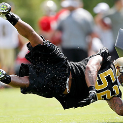 July 29, 2011; Metairie, LA, USA; New Orleans Saints linebacker Jonathan Casillas (52) drives for a tackling drill during the first day of training camp at the New Orleans Saints practice facility. Mandatory Credit: Derick E. Hingle