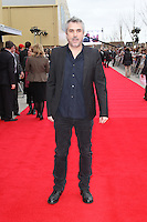 LEAVESDEN - MARCH 31: Alfonso Cuaron attends the Worldwide Grand Opening of the Warner Bros. Studio Tour London  The Making of Harry Potter at Leavesden Studios, Watford, UK. March 31, 2012. (Photo by Richard Goldschmidt)