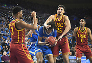 Feb 28, 2019; Los Angeles, CA, USA; UCLA Bruins center Moses Brown (1)is defended by Southern California Trojans forward Bennie Boatwright (25), guard Elijah Weaver (3) and guard Shaqquan Aaron (0) in the second half at Pauley Pavilion. UCLA defeated USC 93-88 in overtime.