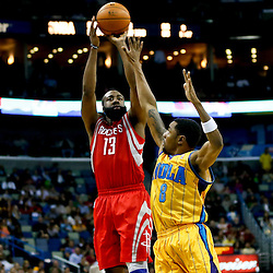 Jan 25, 2013; New Orleans, LA, USA; Houston Rockets shooting guard James Harden (13) shoots over New Orleans Hornets shooting guard Roger Mason Jr. (8) during the second half of a game at the New Orleans Arena. The Rockets defeated the Hornets 100-82. Mandatory Credit: Derick E. Hingle-USA TODAY Sports