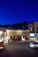 Diners in a restaurant and people strolling on Main Street, Park City Utah at dusk