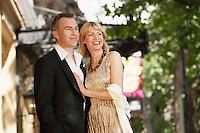 Elegant couple on London street ouside building
