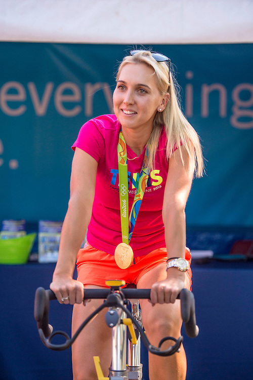 August 24, 2016, New Haven, Connecticut: <br /> Elena Vesnina Rides a spin bike at the Yale New Haven Health booth during Day 6 of the 2016 Connecticut Open at the Yale University Tennis Center on Wednesday, August  24, 2016 in New Haven, Connecticut. <br /> (Photo by Billie Weiss/Connecticut Open)