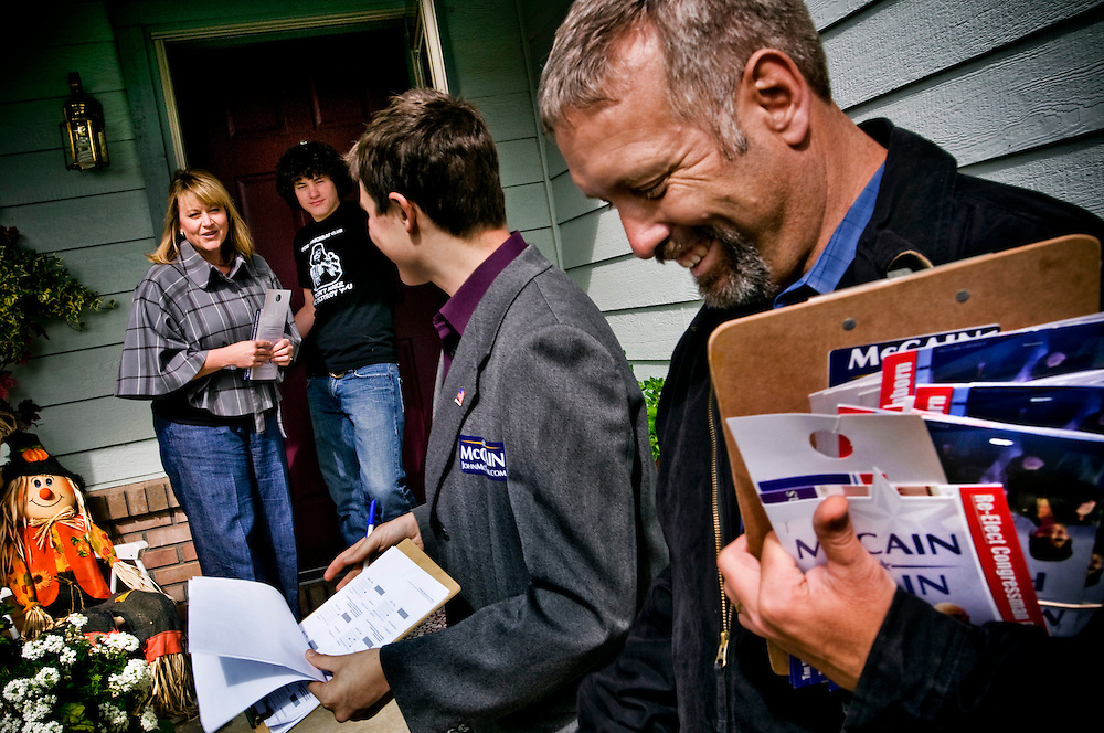 Volunteers for McCain canvasing in Colorado Springs....Alex Johnson (center) can't vote yet, but is already campaigning for McCain along with Pete Knudsen (right)....Photographer: Chris Maluszynski /MOMENT