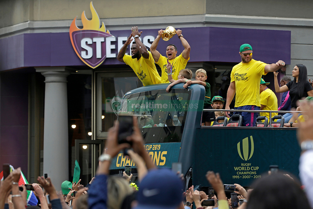 Monday 11th November 2019.<br /> City Hall, Grand Parade,<br /> And City Centre, Cape Town,<br /> Western Cape,<br /> South Africa.<br /> <br /> SPRINGBOKS CELEBRATE WINNING THE RUGBY WORLD CUP CHAMPIONSHIP IN 2019 WITH A COUNTRYWIDE VICTORY TOUR!<br /> <br /> SPRINGBOKS RUGBY WORLD CUP VICTORY TOUR CAPE TOWN!<br /> <br /> South African Captain Siya Kolisi gets the crowd going as South African Wing Cheslin Kolbe holds the Web Ellis Cup as he celebrates with his team mates and excited fans taking photos and selfies while they celebrate the Springboks driving past in their open top bus in the Cape Town City Centre.<br /> <br /> The reigning Rugby World Cup Champions namely the South African Springbok Rugby Team, celebrates winning the Webb Ellis Cup during the International Rugby Football Board Rugby World Cup Championship held in Japan in 2019 with their Victory Tour that culminated in the final city tour taking place in Cape Town. Thousands of South African fans filled the streets of the city all trying their best to show their support for their beloved Springboks and to celebrate them winning the Rugby World Cup for the third time. South Africa previously won the Rugby World Cup in 1995, 2007 and now again in 2019. South African Springbok Captan Siya Kolisi took the opportunity to speak to the gathered crowd about how something like this brings unity and that we should live together as a nation that practices what is known as ubuntu. Ubuntu is a quality that includes the essential human virtues of compassion and humanity. This image taken in Cape Town on Monday 11th November 2019.<br /> <br /> This image is the property of Seven Bang Media Group (Pty) Ltd, hereinafter referred to as SBM.<br /> <br /> Picture By: SBM / Mark Wessels. (11/11/2019).<br /> +27 (0)61 547 2729<br /> mark@sevenbang.com<br /> www.sevnbang.com<br /> <br /> Copyright © SBM. All Rights Reserved.