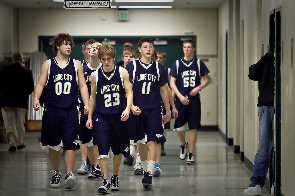JEROME A. POLLOS/Press..J.J. Stoddard leads his Lake City teammates out of the tunnel at the Idaho Center and to the court for the second half of their match-up against Rocky Mountain High Friday at the state 5A boys basketball tournament at Idaho Center in Nampa. The T-Wolves were eliminated from the tournament after the 72-52 loss to the Grizzlies.