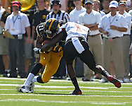 August 31 2013: Iowa Hawkeyes wide receiver Kevonte Martin-Manley (11) is hit by Northern Illinois Huskies safety Dechane Durante (1) after a catch during the first quarter of the NCAA football game between the Northern Illinois Huskies and the Iowa Hawkeyes at Kinnick Stadium in Iowa City, Iowa on August 31, 2013. Northern Illinois defeated Iowa 30-27.