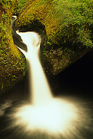 Eagle Creek cascades into Punchbowl Falls in the Columbia River Gorge, Oregon.