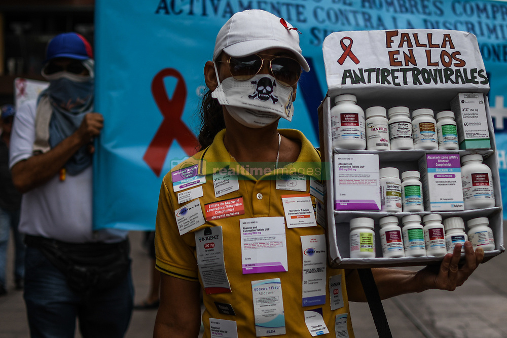 April 18, 2018 - Caracas, Distrito Capital, Venezuela - A demonstrator seen holding several medicine boxes during the Heatlh protest front of the Ministry of Health..Patients with HIV and patients with organ transplants protested at the Ministry of Health as they demanded medicines and solutions in the absence of medical supplies and also requested the presence of the Minister of Health Luis Lopez, while he did not show up, and sent a person in charge of the ministry who received a document from the organizers of the protest and arrange a meeting with Vice Minister Yasin Aleman. Protesters gave a 24-hour warning to the minister, otherwise they would march to the Miraflores Palace and ask to speak with the president. (Credit Image: © Roman Camacho/SOPA Images via ZUMA Wire)