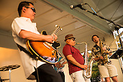 Big Blu Soul Revue saxophonist Hermann Lara, center, performs as guests enjoy heat and music during the City of Milpitas Summer Concert Series at Murphy Park in Milpitas, California, on July 26, 2016. (Stan Olszewski/SOSKIphoto)