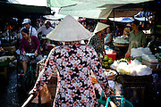 A woman walks through the market in Chau Doc, Vietnam.