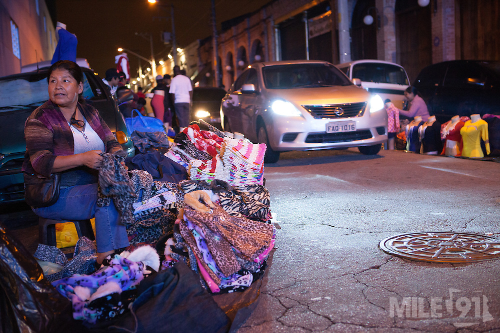 Clothes being sold in the illegal nightmarkets on the streets of São Paulo, Brazil.<br /> <br /> Nearly 90% of the immigrants arriving in São Paulo end up working in the textile industry. Today there are about 20,000 sewing shops in São Paulo and 400,000 immigrants working in the clothing sector.