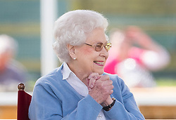 © Licensed to London News Pictures. 09/05/2018. Windsor, UK. Queen Elizabeth II watches her horse 'Sparkles' in competition at the 75th Royal Windsor Horse Show . The five day event takes place in the grounds of Windsor Castle. The Queen and the Duke of Edinburgh usually attend. Photo credit: Peter Macdiarmid/LNP