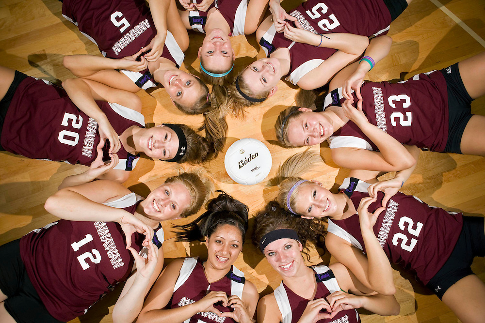 Annawan High School varsity volleyball players pose at Annawan High School in Annawan, IL on Thursday, August 18 with their hands over their hearts in memory of their late teammate, Emily VandeVoorde, who lost her life in a car accident on her way to a summer practice