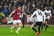 West Ham United Forward Chicharito (17) and Fulham Midfielder Havard Nordtveit (16) in action during the Premier League match between West Ham United and Fulham at the London Stadium, London, England on 22 February 2019.