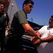 """A smuggler of undocumented immigrants is arrested in Eagle Pass, Texas. Small border towns like Eagle Pass, lacking the federal funds of larger cities are under siege by illegal immigrants trafficking drugs into the United States. """" I'm uneasy myself and I'm trained for this. They're haulin ' drugs just down from my house, """" the Eagle Pass Chief of Police told the New York Times. Please contact Todd Bigelow directly with your licensing requests. PLEASE CONTACT TODD BIGELOW DIRECTLY WITH YOUR LICENSING REQUEST. THANK YOU!"""