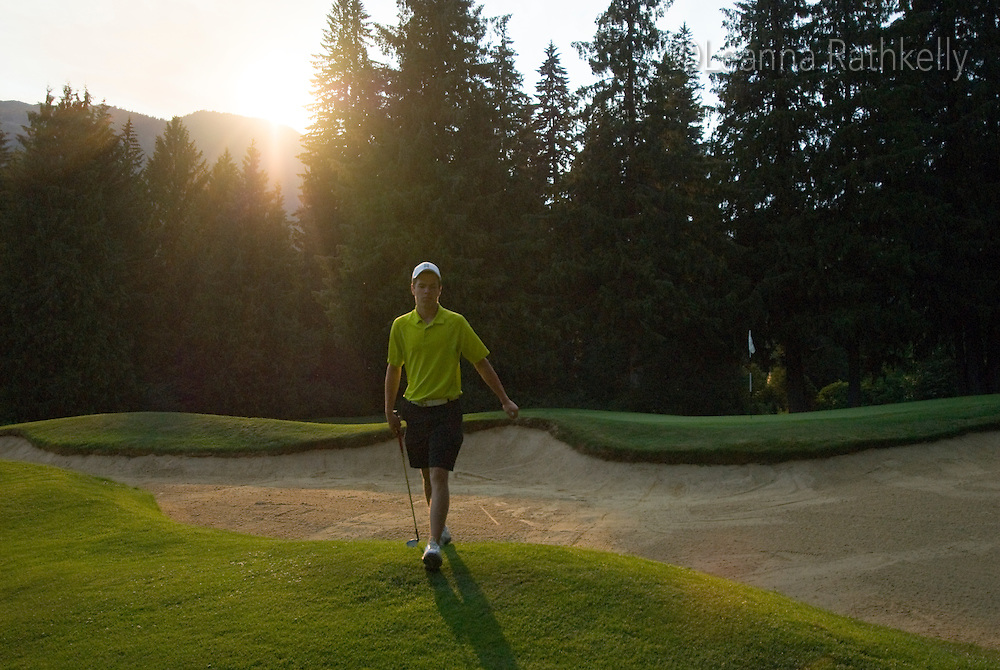 Brett Kelly golfs the Whistler Golf Course on a summer evening in Whistler, BC Canada