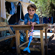Najah, 4, a Kurdish Syrian refugee from Aleppo, plays on a table her Grandpa Jameel made, which sits outside of her family&rsquo;s tent in Ritsona refugee camp, an hour north of Athens, Greece. <br /> <br /> extended family have been stranded in Greece since they arrived in March 2016, after the Balkan borders were closed to all refugees. Referring to their extended family, Grandpa Jameel said, &ldquo;We are happy to go anywhere, as long as we can stay together.&rdquo;