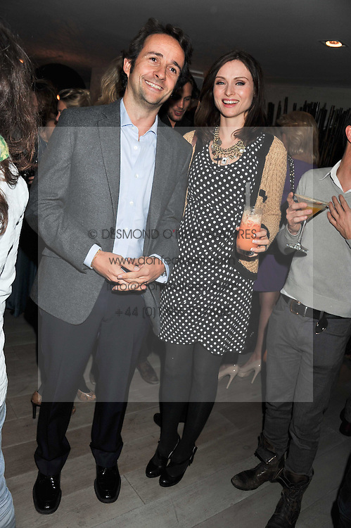 SOPHIE ELLIS-BEXTOR and MATTHEW HERMER at a party to launch Senkai - London's first modern Japanese-inspired restaurant at 65 Regent Street, London on 26th October 2011.