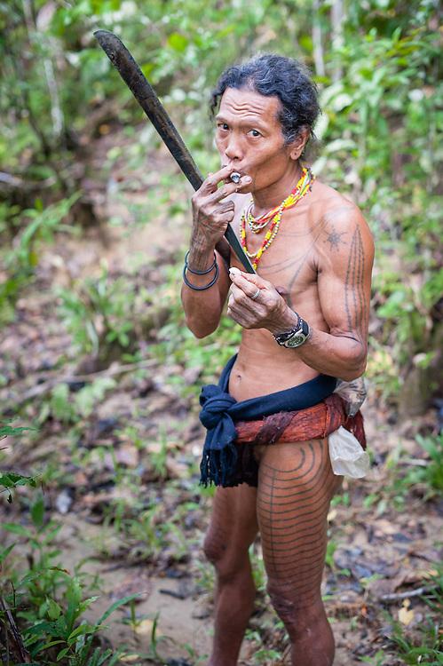 Mentawai indigenous man with machete (Indonesia).