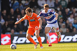 Blackpool's midfielder Andrew Halliday and QPR's midfielder Tommy Carroll  - Photo mandatory by-line: Mitchell Gunn/JMP - Tel: Mobile: 07966 386802 29/03/2014 - SPORT - FOOTBALL - Loftus Road - London - Queens Park Rangers v Blackpool - Championship