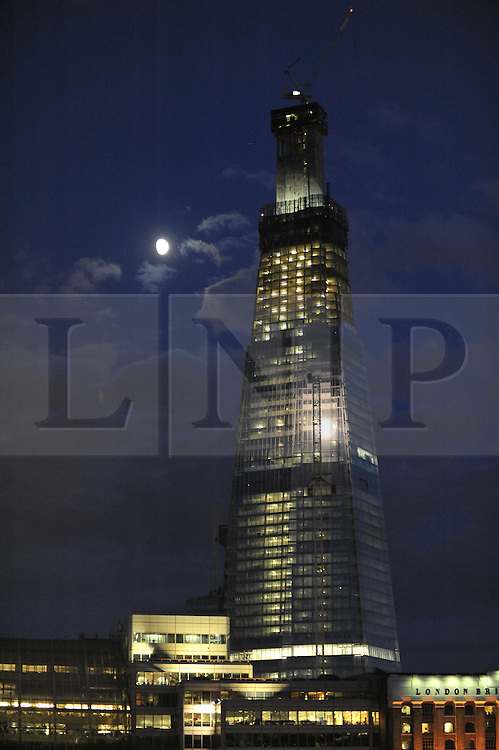 © under license to London News Pictures. LONDON, UK  12/06/2011.The Shard seen in June 2010. When the skyscraper is completed in 2012, it will be the tallest building in the European Union and the 45th tallest building in the world. The building has been designed with an irregular triangular shape from the base to the top. It will be clad entirely in glass. The viewing gallery and open-air observation deck will be on the top (72nd) floor. It is the second tallest free-standing structure in the United Kingdom Photo credit should read Stephen Simpson/LNP.
