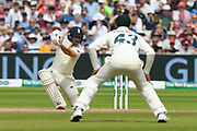 Rory Burns of England hits the ball to the boundary for four runs during the International Test Match 2019 match between England and Australia at Edgbaston, Birmingham, United Kingdom on 3 August 2019.