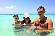 Family swimming at Guadalavaca, Holguin, Cuba.