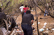 A group of about twenty illegal immigrants, who crossed into the U.S. from Mexico, moves at Little Tucson, east of Sells and south of Route 86 on the Tohono O'odham Reservation, Arizona, USA.