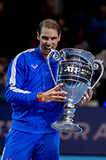 Rafael Nadal of Spain bites his year end ATP World Number One trophy  during the Nitto ATP Finals at the O2 Arena, London, United Kingdom on 15 November 2019.