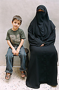 A mother and her son sit in the courtyard of their house in Jordan. Taken as part of an assignment for Reprieve.