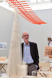 "© Licensed to London News Pictures. 12/09/2018. LONDON, UK. Internationally renowned architect and Honorary Royal Academician Renzo Piano at a preview of ""Renzo Piano: The Art of Making Buildings"", an exhibition comprising 16 of his most significant projects.  He is seen next to a model of The Shard in London.   The exhibition runs 15 September to 20 January 2019 at the Royal Academy of Arts in Piccadilly.  Photo credit: Stephen Chung/LNP"