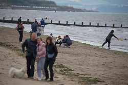 © Licensed to London News Pictures.16/08/2020 Edinburgh,UK. Members of the public are seen enjoying Sunday noon at Portobello Beach in Edinburgh, Scotland. Weather forecast for Edinburgh say maximum temperatures reach 15 degrees. Concerns are growing over the potential of widespread job losses in Edinburgh tourism industry two-thirds of the city's hotels rooms may be left lying empty this month. Photo credit: Marcin Nowak/LNP