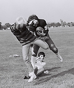 Teenagers playing American Football in a west London park, UK, 1982