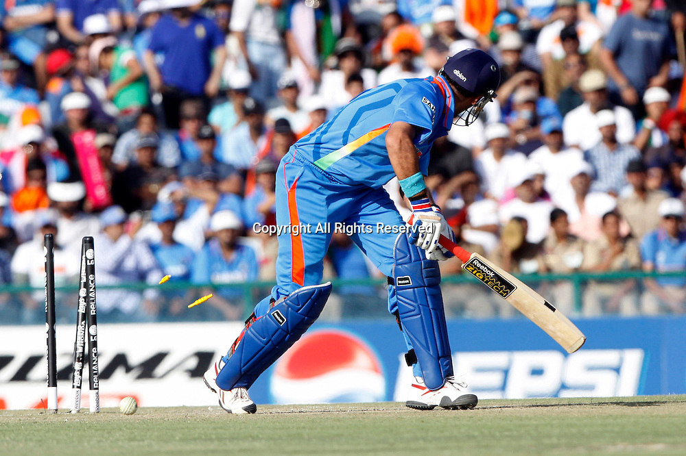 30.03.2011 Cricket World Cup from the Punjab Cricket Association Stadium, Mohali in Chandigarh. India v Pakistan.Yuvraj Singh of India bowled out during the match of the ICC Cricket World Cup between India and Pakistan.