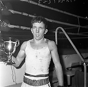 26/01/1962<br /> 01/26/1962<br /> 26 January 1962<br /> Irish Amateur National Junior Boxing Championships at the National Stadium, Dublin. P. Burke, (Crumlin) Flyweight Junior Champion with cup.
