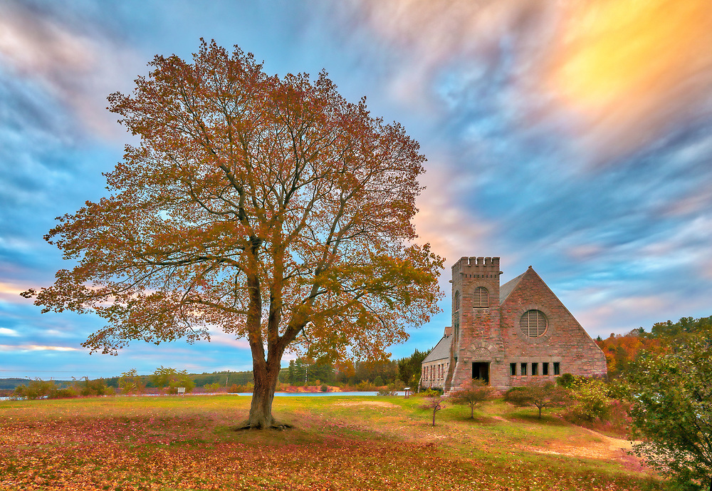 Abandoned Old Stone Church in West Boylston, MA on a beautiful autumn morning at sunrise. This National Historic Site is located on the banks of the Wachusett Reservoir and the beautiful morning light painted this Central Massachusetts historic landmark, oak tree and cloudscape in beautiful hues.<br /> <br /> Old Stone Church photography images are available as museum quality photo, canvas, acrylic, wood or metal prints. Wall art prints may be framed and matted to the individual liking and interior design decoration needs:<br /> <br /> https://juergen-roth.pixels.com/featured/old-stone-church-juergen-roth.html<br /> <br /> Good light and happy photo making!<br /> <br /> My best,<br /> <br /> Juergen<br /> Licensing: http://www.rothgalleries.com<br /> Photo Prints: http://fineartamerica.com/profiles/juergen-roth.html<br /> Photo Blog: http://whereintheworldisjuergen.blogspot.com<br /> Instagram: https://www.instagram.com/rothgalleries<br /> Twitter: https://twitter.com/naturefineart<br /> Facebook: https://www.facebook.com/naturefineart