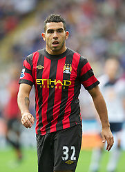 BOLTON, ENGLAND - Sunday, August 21, 2011: Manchester City's Carlos Tevez in action against Bolton Wanderers during the Premiership match at the Reebok Stadium. (Pic by David Rawcliffe/Propaganda)