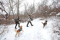 Duck hunters take a break with their dogs and their catch at Prairie Creek Reservoir in Muncie, Indiana Monday December 6. The reservoir was closed Monday so hunters could participate in a goose reduction hunt. The hunters were also able to shoot any waterfoul.