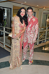ALEX REID and NIKKI MANASHE at the 6th annual Asian Awards held at The Grosvenor House Hotel, Park Lane, London on 8th April 2016.