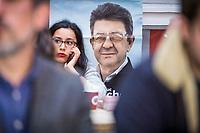 Sophia Chikirou l'assitante personnelle et cheffe de com de Jean-Luc Mélanchon, au cartier général de son champion, dont les portraits ornent les murs. Soirée électorale de Jean-Luc Mélenchon et la France insoumise. Dans la  salle Belushi's<br /> 5 rue de Dunkerque, 75010 Paris.<br /> Dimanche 24 avril 2017, Paris.<br /> © Nicolas Righetti / Lundi13
