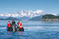 Tourists looking the Fairweather Range across Cross Sound from the Inin Islands in Cross Sound, Alaska.